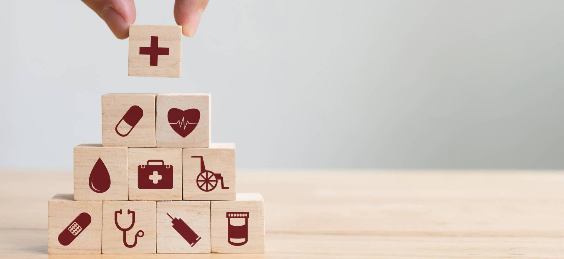Wooden cubes with red medical motifs